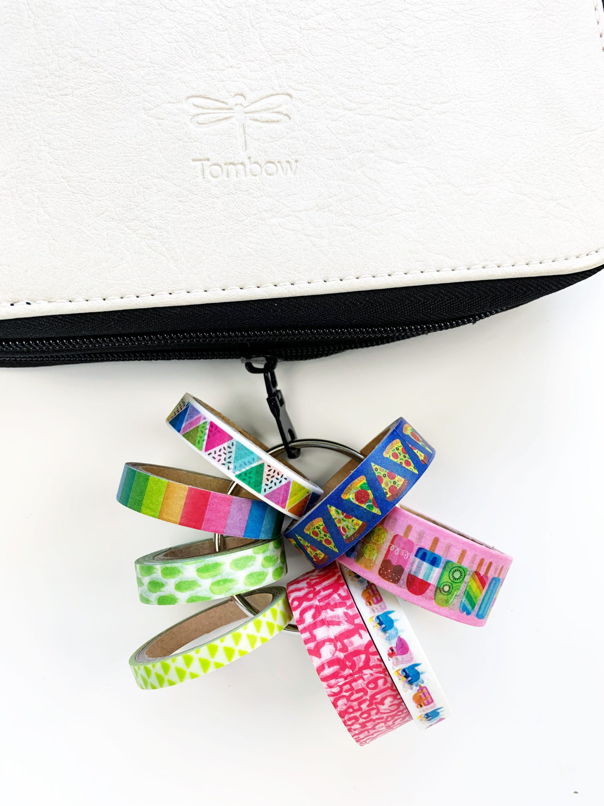 Use the zipper of the Tombow Zippered Marker Storage to add a ring with washi tape. #tombow #washitape